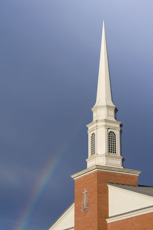 Church steeple and rainbow shot shortly after a storm passed