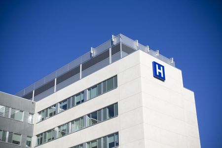 Modern hospital against deep blue sky shot in summer photo
