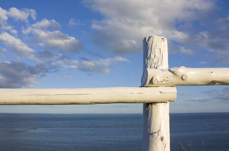 Rustic fence overlooking atlantic ocean shot in PEI, Canada photo