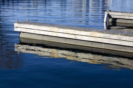 wooden docks in calm water shot from toronto island