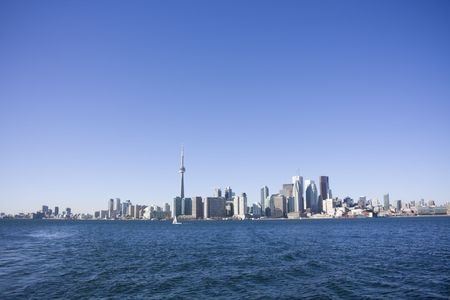 View of toronto from toronto island with docks in the foreground photo