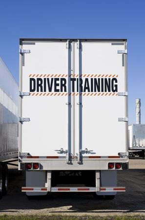 truck driver: Driver training sign on back of truck
