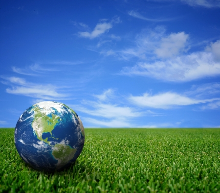 earth pollution: Landscape with globe Stock Photo