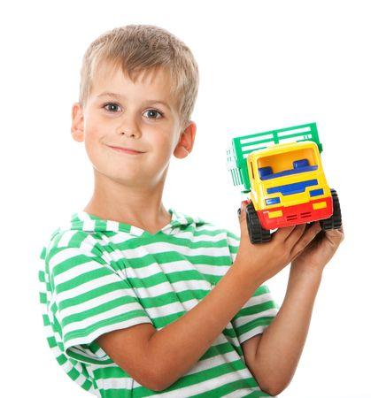 Boy holding car  isolated on white background Stock Photo - 5721913