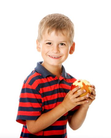Boy holding an apple  isolated on white background photo