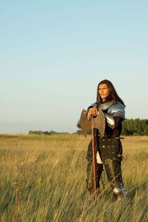 Medieval knight in the field with an axe Stock Photo - 5721915
