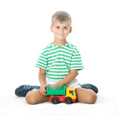 Boy holding car  isolated on white background photo