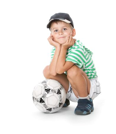 Boy holding soccer ball  isolated on white background Stock Photo - 5763344