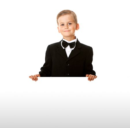 Boy holding a banner isolated on white background photo