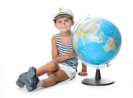 Boy holding a globe  isolated on white background photo