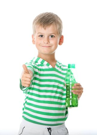 Boy drinking water isolated on white background photo