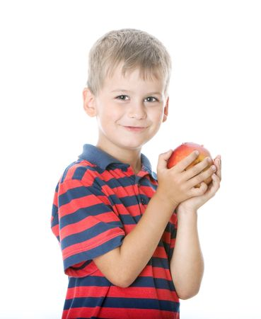 felix: Boy holding an apple  isolated on white background