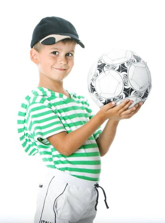Boy holding soccer ball  isolated on white background photo