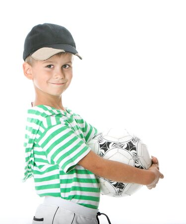 Boy holding soccer ball  isolated on white background Stock Photo - 5808592
