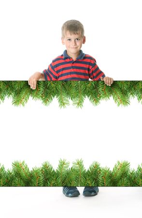 Boy holding a christmas banner isolated on white background photo