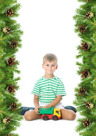 Christmas framework with boy isolated on white background photo