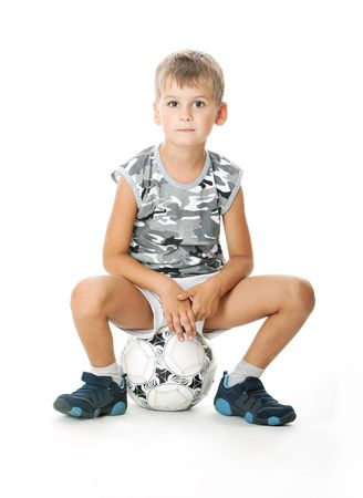 little boy: Boy holding soccer ball  isolated on white background