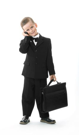 Boy holding a briefcase isolated on white background photo