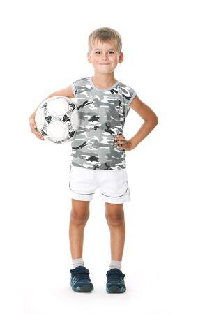 Boy holding soccer ball  isolated on white background photo