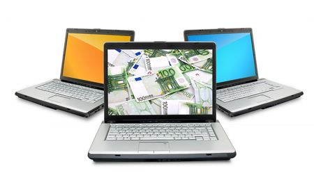 Open laptops with money  isolated on white background photo