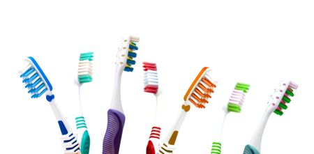 packshot: Colorfull toothbrushes  in a cup isolated on white background  Stock Photo