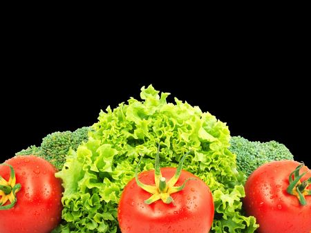 Low-calorie raw vegetables isolated on black background photo