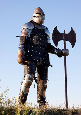 Medieval knight in the field with an axe Stock Photo - 6534933