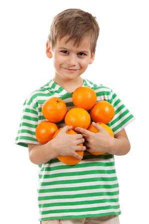 Boy holding oranges isolated on white background photo