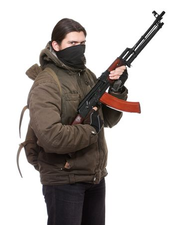 Terrorist with weapon on a white background Stock Photo - 6597886