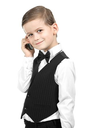 Boy holding a cellphone isolated on white background photo
