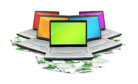 Open laptop with money  isolated on white background photo