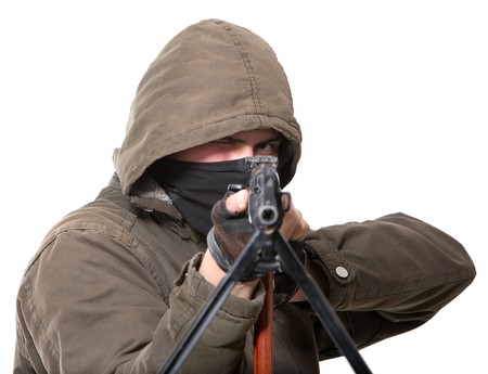 Terrorist with weapon on a white background Stock Photo - 7130035