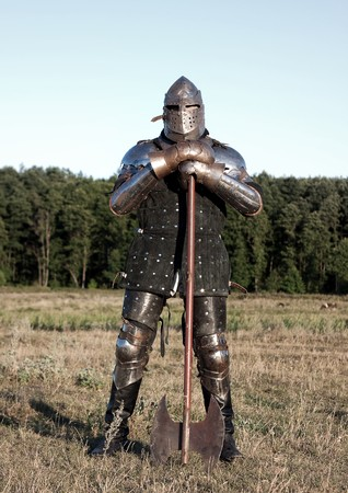 chivalry: Medieval knight in the field with an axe Stock Photo