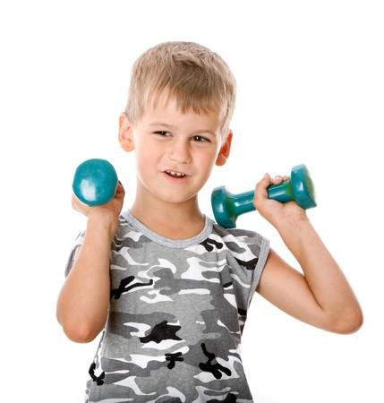 bodybuilding boy: Boy holding dumbbells  isolated on white background