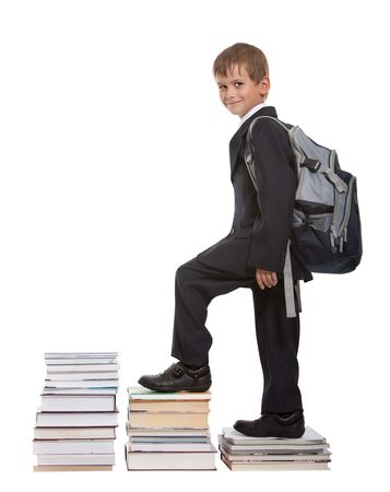 going up: Education success graph - successful schoolboy isolated on white background