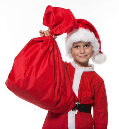 Boy holding a sack isolated on white background photo
