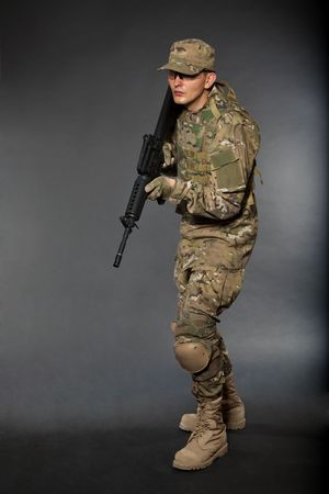 Soldier with rifle on a black background Stock Photo - 7742515