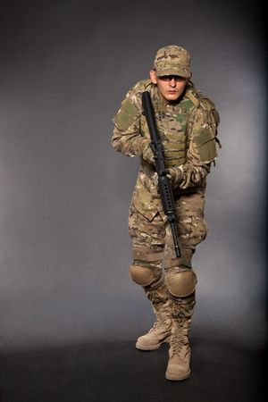 army uniform: Soldier with rifle on a black background Stock Photo