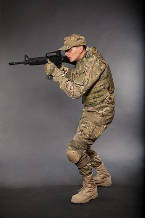 Soldier with rifle on a black background Stock Photo - 7742518