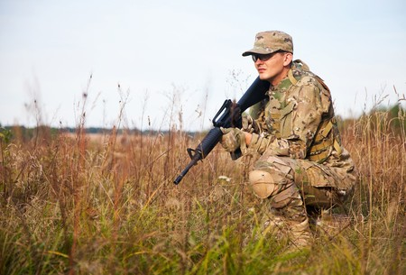 one armed: Soldier with a rifle in the field