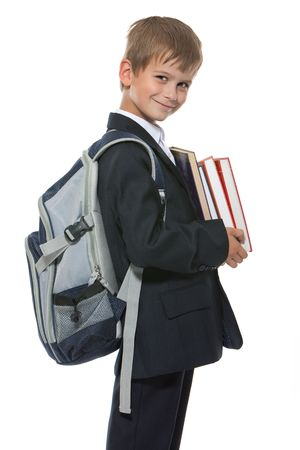 ni�os saliendo de la escuela: Chico celebraci�n de libros aislados en un fondo blanco  Foto de archivo