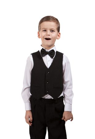 child singing: Boy in a suit singing. Shot in studio