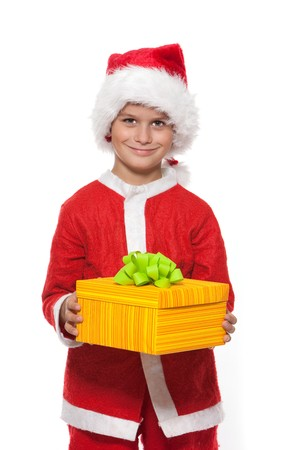 Boy holding a christmas gift isolated on white background photo