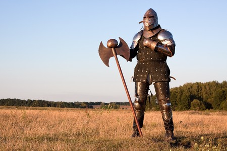 Medieval knight in the field with an axe Stock Photo - 7853326