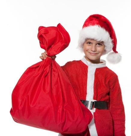 Boy holding a sack isolated on white background Stock Photo - 8056226