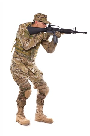 Soldier with rifle on a white background Stock Photo - 8056275