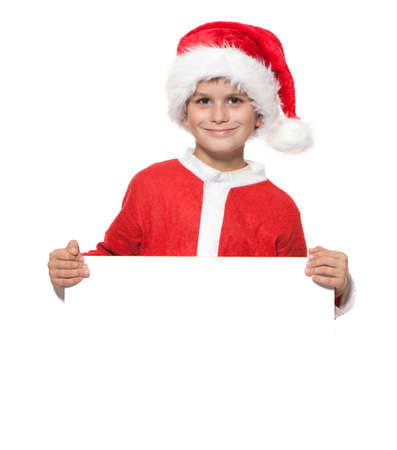 Boy holding a christmas poster isolated on white background Stock Photo - 8088269