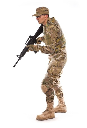 Soldier with rifle on a white background Stock Photo - 8162221