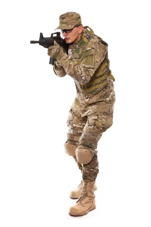 Soldier with rifle on a white background photo