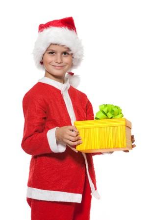 Boy holding a christmas gift isolated on white background photo